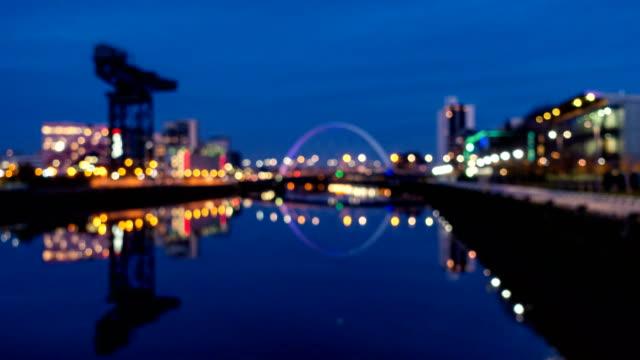 t/l defocused of clyde arc bridge at dusk, glasgow, scotland - glasgow scotland stock videos & royalty-free footage