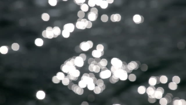 stockvideo's en b-roll-footage met defocused of sea - brightly lit