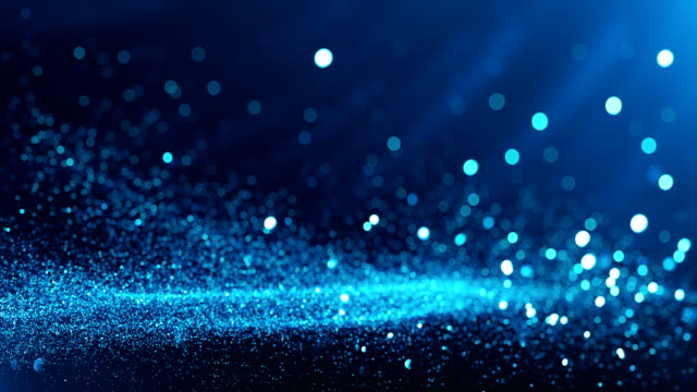 defocused particles background (cyan / blue) - loop - blue stock videos & royalty-free footage