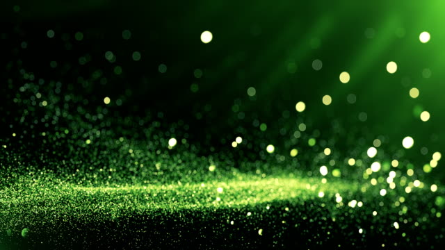 vídeos de stock e filmes b-roll de defocused particles background (green) - loop - green