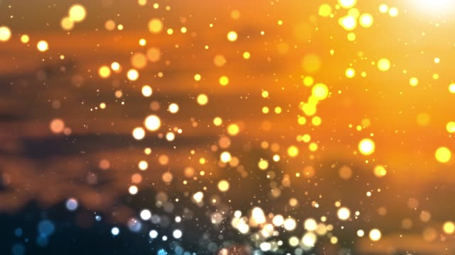 4k defocused particles background (loopable) - orange colour background stock videos & royalty-free footage