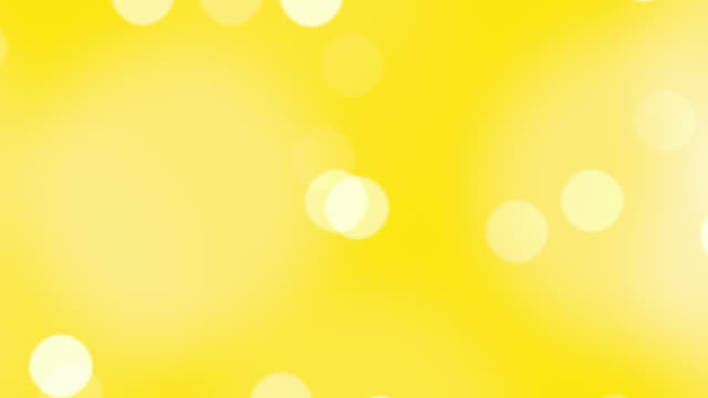 defocused particles floating in a seamless loop. - yellow background stock videos & royalty-free footage