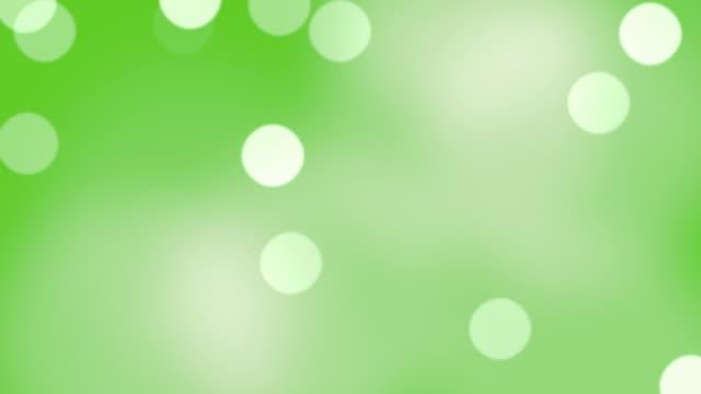 vidéos et rushes de flou particules flottantes dans une boucle sans faille. - cierge magique