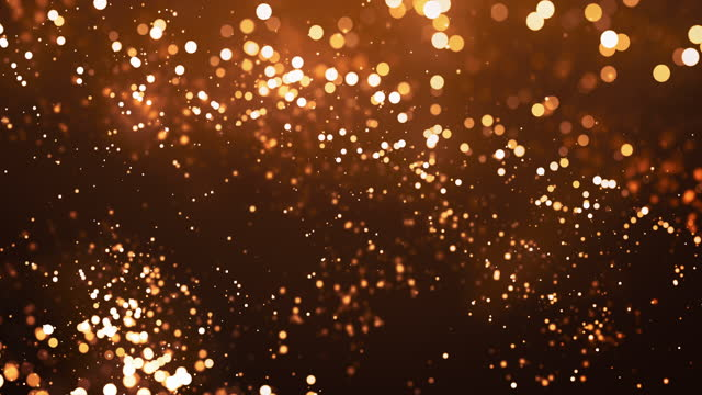 avfokuserade partiklar i slow motion - guldfärgad, jul, celebration - abstrakt bakgrundsanering - loopable - guldmedalj bildbanksvideor och videomaterial från bakom kulisserna