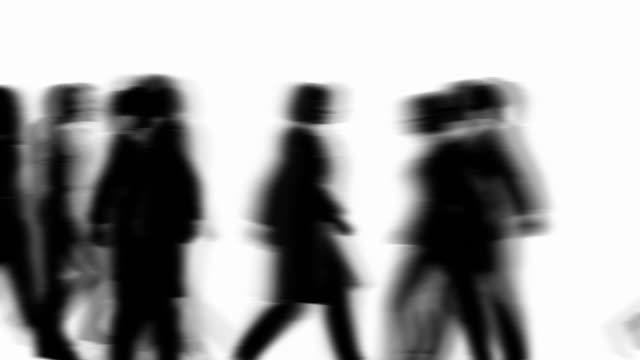 defocused people walking by (silhouette) - medium group of people stock videos & royalty-free footage