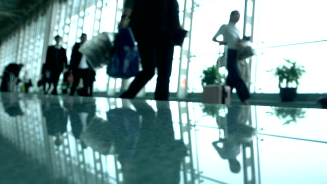 Defocused people walking in airport