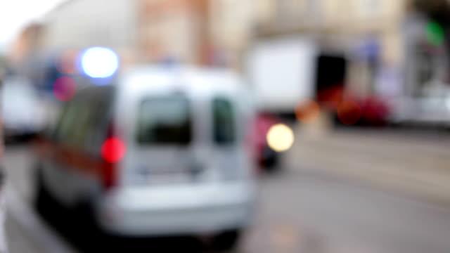 Defocused Police Cars Stand On Signal