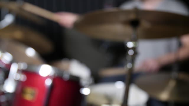 defocused shot of a drum kit being played - drum percussion instrument stock videos & royalty-free footage