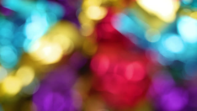 defocused shot of colourful toffee wrappers slowly rotating - karamell stock-videos und b-roll-filmmaterial