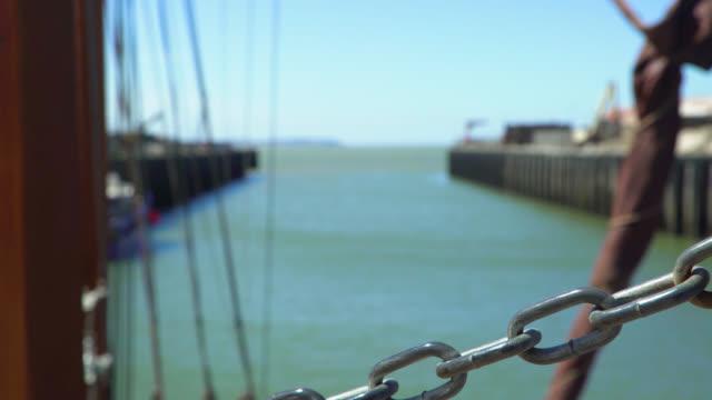 defocused shot of harbour entrance - coastal feature stock videos & royalty-free footage