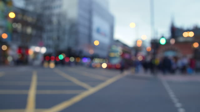 Defocused shot of people using a pedestrian crossing on London's Euston Road