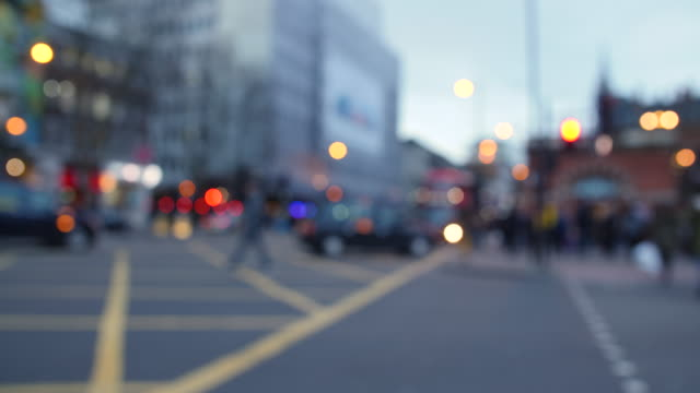 defocused shot of people using a pedestrian crossing on london's euston road - soft focus stock videos & royalty-free footage