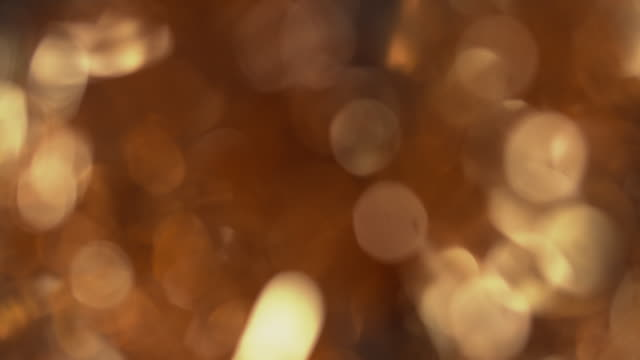 defocused shot on a shimmering gold tinsel christmas tree. - christmas decoration stock videos & royalty-free footage