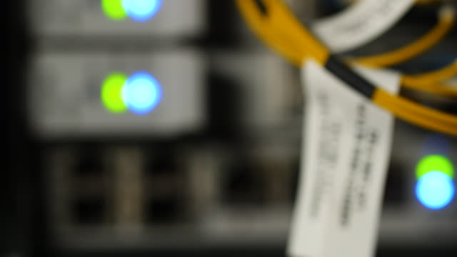 defocused shot panning across a computer server. - big data stock videos & royalty-free footage