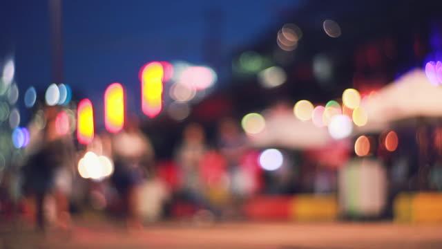 Defocused Silhouettes of people crossing.