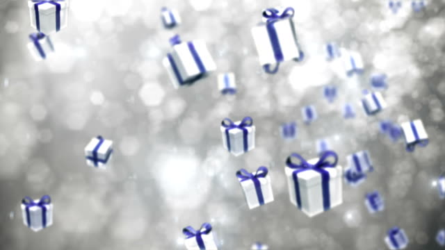 defocused silver particles with gift boxes - loopable - christmas present stock videos and b-roll footage