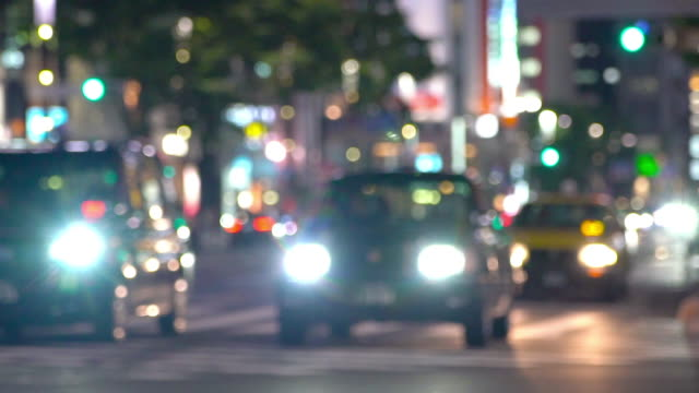 defocused slow motion night traffic in ginza crossing area in tokyo, japan - ginza stock videos & royalty-free footage
