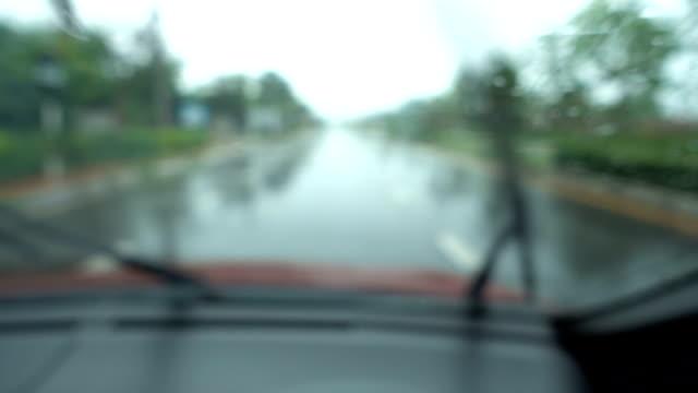 defocused slow motion of driving on rainy highway. - june stock videos & royalty-free footage