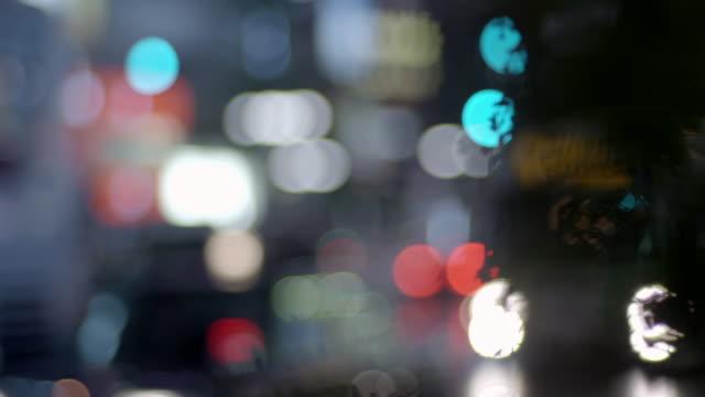 defocused street scene in tokyo - bright colour stock videos & royalty-free footage