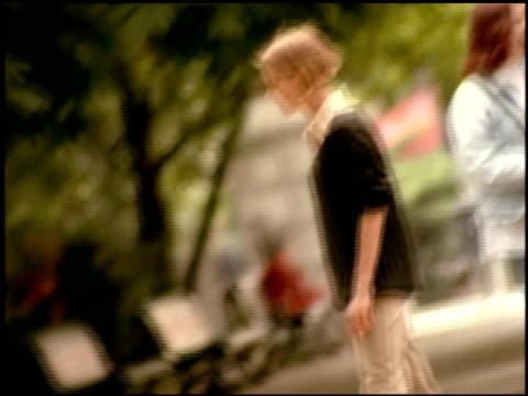 defocused track over boys and girls kicking football around in park, berlin - geköpft stock-videos und b-roll-filmmaterial