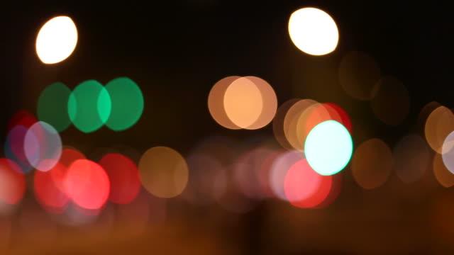 defocused traffic lights - headlight stock videos & royalty-free footage