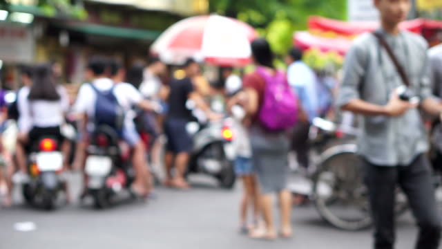 defocused traffic on a crossroad in hanoi - vietnam stock videos & royalty-free footage