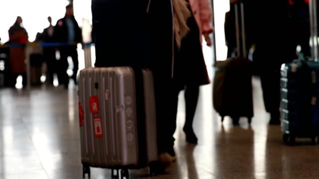 Defocused travelers walking at airport
