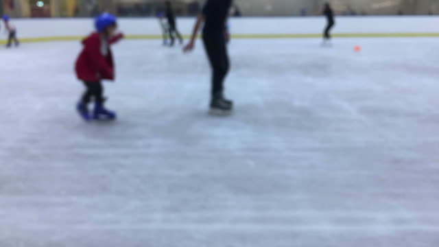 defocused , unidentified people ice skating , time lapse - ice skating stock videos & royalty-free footage