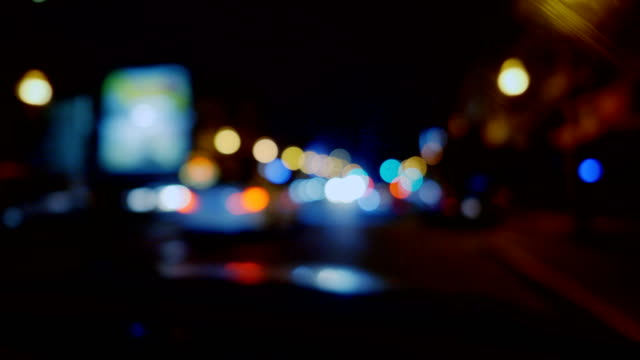 vídeos de stock e filmes b-roll de de-focused view of night city. - city