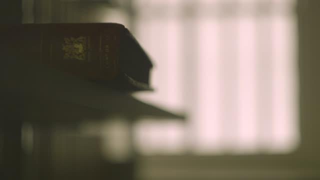 las defocused view of old book - e book stock videos & royalty-free footage