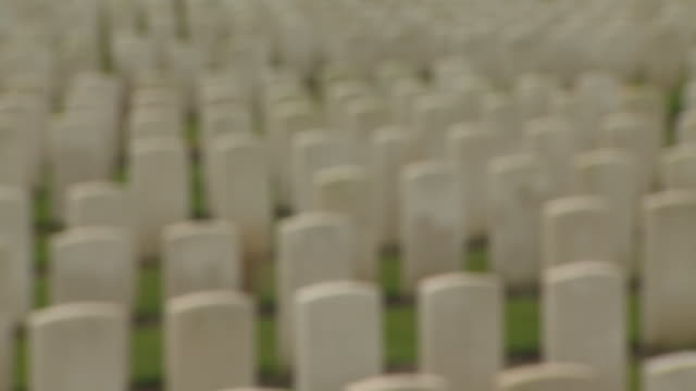 Defocused view of tombstones in a WWI cemetery, Belgium.