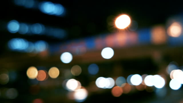 defocused view of traffic in beijing (driving/process plates) - fanale anteriore video stock e b–roll