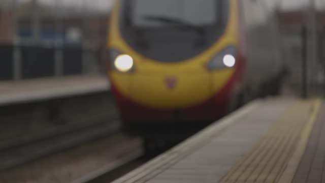 defocused view of train arriving - high speed train stock videos & royalty-free footage