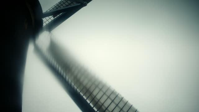 defocused views of blades turning on old windmills - wind turbine stock videos & royalty-free footage