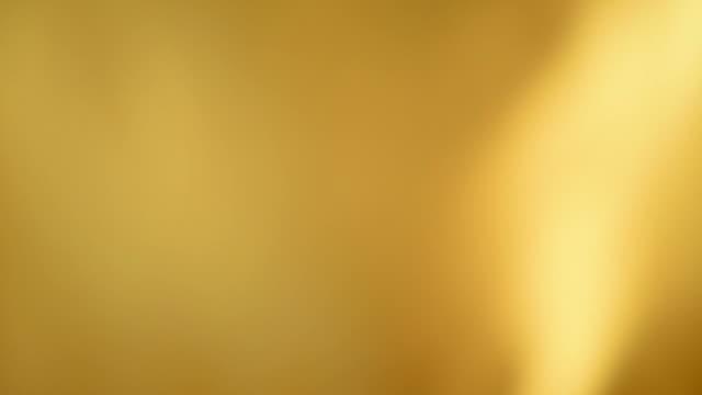 Defocused waving yellow satin