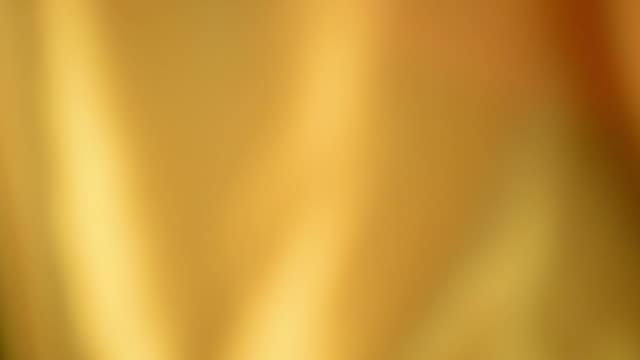 defocused waving yellow satin - silk stock videos and b-roll footage