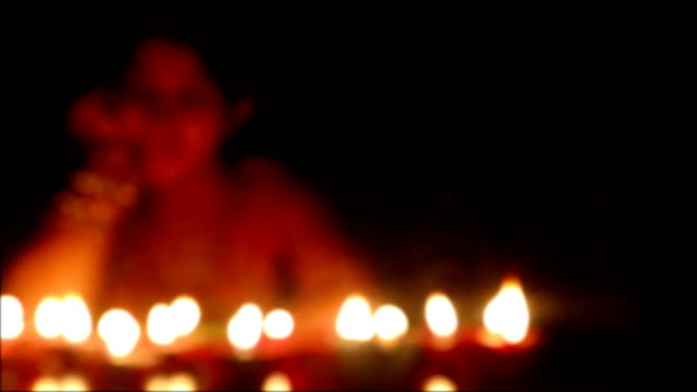 defocused women celebrating diwali festival at home - oil lamp stock videos & royalty-free footage