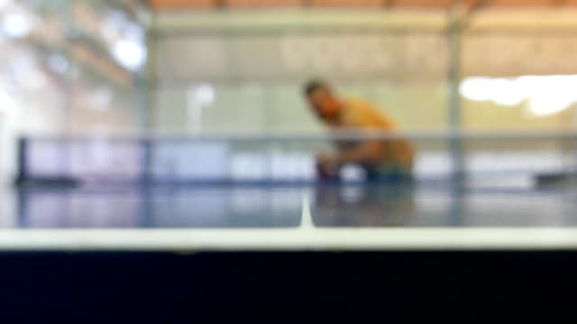 defocussed shot of a man serving the ball in table tennis game - table tennis bat stock videos & royalty-free footage