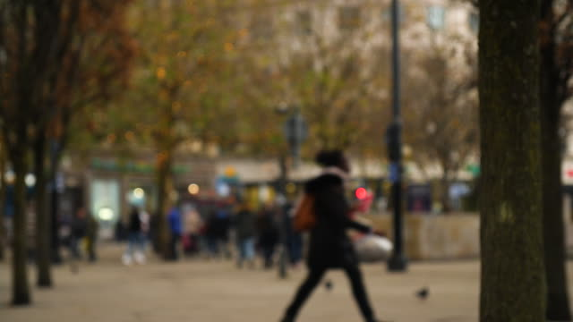 defocussed shot of piccadilly gardens, manchester - high street stock videos & royalty-free footage