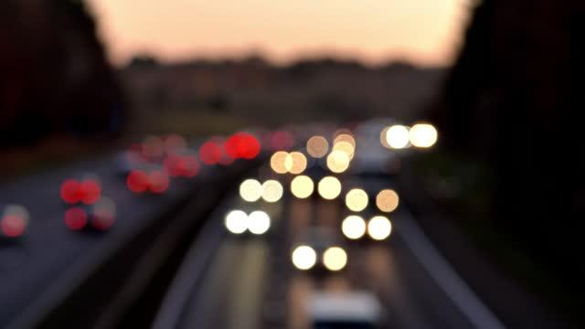 defocussed traffic on major road. realtime lockdown. - motorway stock videos & royalty-free footage