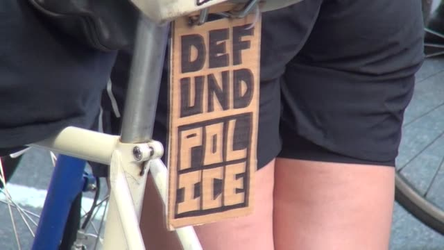 defund police sign on bike - salmini stock videos & royalty-free footage