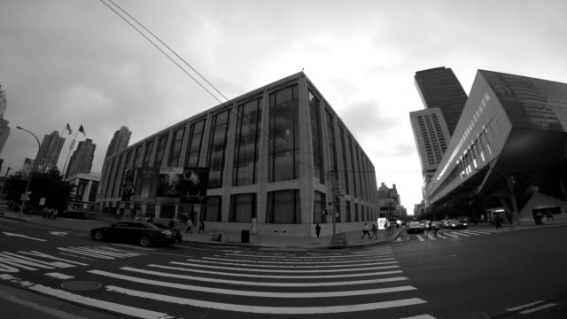 360 degree motion time lapse shot of urban city streets and traffic. new york city landmarks background