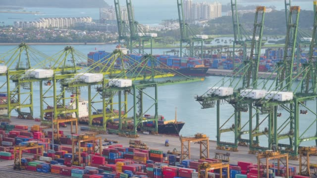 180 degree panning container cargo freight ship with working crane bridge in shipyard in singapore - customs stock videos & royalty-free footage