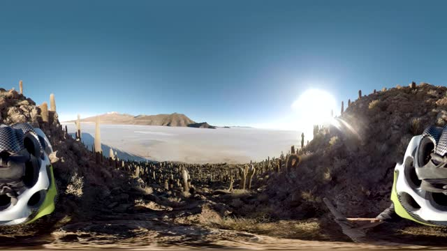 360 degree view of a person in a helmet descending a mountain full of cactus in the salar de uyuni, the largest salt flat in the world. - natural condition stock videos & royalty-free footage