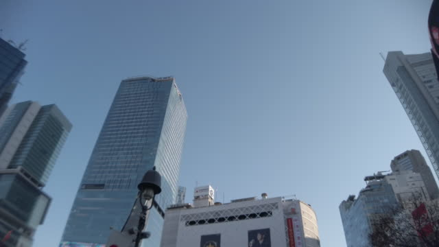 360 degree view. panoramic shibuya cityscape office building - clear sky stock videos & royalty-free footage