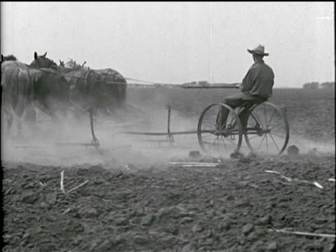 / dehydrated farmland farmer plowing field with horsedrawn plow CU of dried earth in farmer's hands / woman pumping water from well horses and sheep...