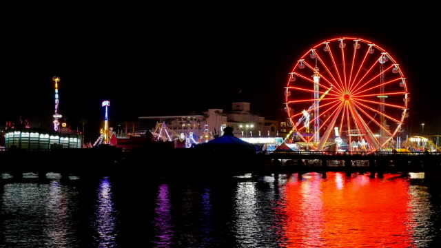 del mar fair funzone reflecting off of the san dieguito lagoon - ferris wheel stock videos & royalty-free footage