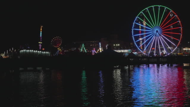 del mar fair funzone reflecting off of the san dieguito lagoon - big wheel stock videos & royalty-free footage