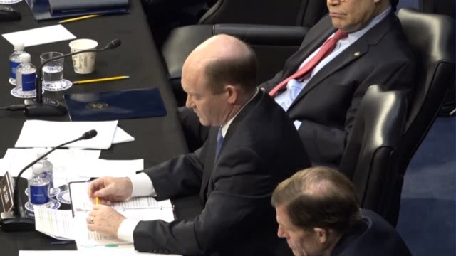 delaware senator chris coons reads from a prepared statement at a meeting of the senate judiciary committee prior to a vote on sending the nomination... - senate judiciary committee stock videos & royalty-free footage