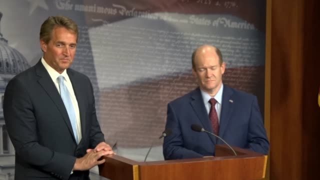 vídeos de stock, filmes e b-roll de delaware senator chris coons tells reporters at a news conference after a bipartisan bill to protect special counsel robert mueller was objected to... - política e governo
